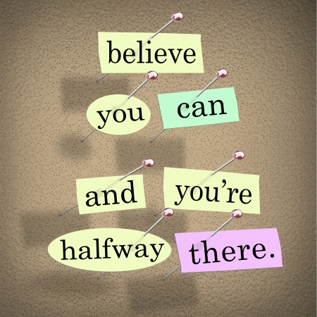 dedication: The saying Belive You Can and Youre Halfway There on pieces of paper pinned to a bulletin board to symbolize belief, confidence, dedication and determination Stock Photo