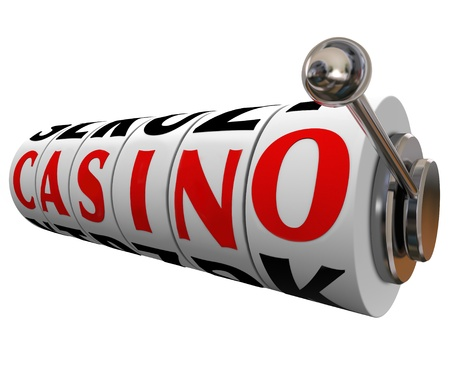 The word Casino on slot machine wheels to symbolize a fun gambling destination such as Las Vegas or other entertainment venues where betting takes place photo