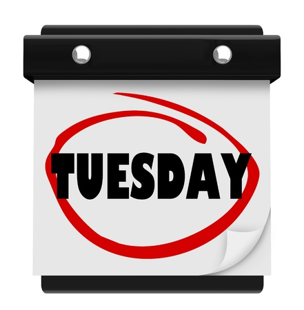 The word Tuesday circled on a small wall calendar to illustrate the day of the week and remind you of your schedule or appointment photo