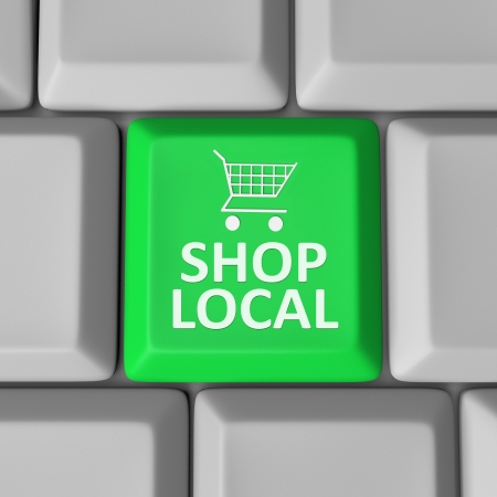 web shop: A green computer key with the words Shop Local and a shopping cart to encourage you to support your community by spending money in your home town Stock Photo