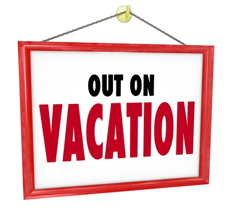 Out on Vacation words on hanging sign for store window or office wall to tell customers or co-workers that you are temporarily off on holiday or break to relax and enjoy life