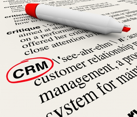 The word, phrase or acronym CRM which means Customer Relationship Management defined in a dictionary with the definition circled by a red marker photo