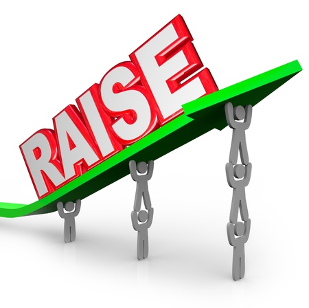 pay raise: The word Raise on an arrow lifted by workers who are asking for an increase in pay for a job well done Stock Photo