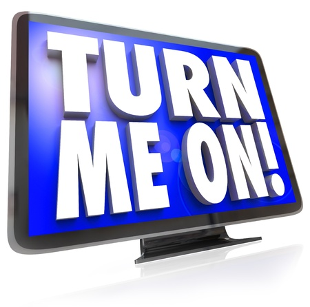 An HDTV television with words Turn Me On telling you to watch the cable satellite or broadcast TV for a special program or event Stock Photo - 19421091