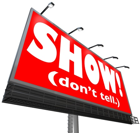 tell stories: The words Show Dont Tell on a red billboard sign to tell writers to be illustrative, descriptive and exciting in sharing action in a story to move the plot along