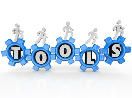 A team of men or workers turns gears with the word Tools inside them to illustrate working together to create synergy and being empowered and made able to accomplish a task