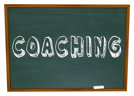 participate: The word Coaching on a blackboard or chalkboard to symbolize learning, team skills and motivation from an effective leader or teacher