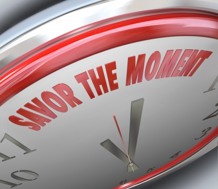 cherishing: The words Savor the Moment on a clock face to illustrate the fleeting nature of time and enjoying a period of happiness and glory Stock Photo