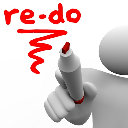 redesign: A man with a marker or pen writes the word Re-Do to illustrate a need to revise, change or improve to adapt to changing conditions or requirements