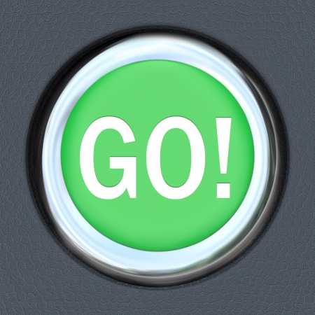 hurrying: The word Go on a car start button to illustrate acceleration and movement forward toward a goal or to speed up for a race or progress down a road or path to success