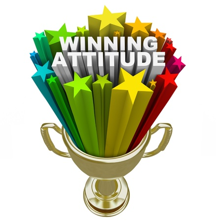 good attitude: The words Winning Attitude in a gold trophy with colorful stars and fireworks shooting around it to illustrate the power of a positive outlook on life, sports or career