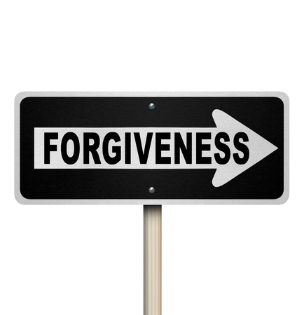 The word Forgiveness on a one way road sign to symbolize being sorry, offering an apology and seeking someone forgiving you and offering redemption or absolution Stock Photo - 19587291
