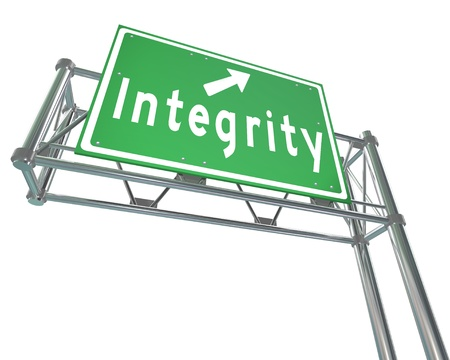 virtue: The word Integrity on a green freeway road sign pointing the way to trustworthiness, credibility, virtue and other positive qualities Stock Photo