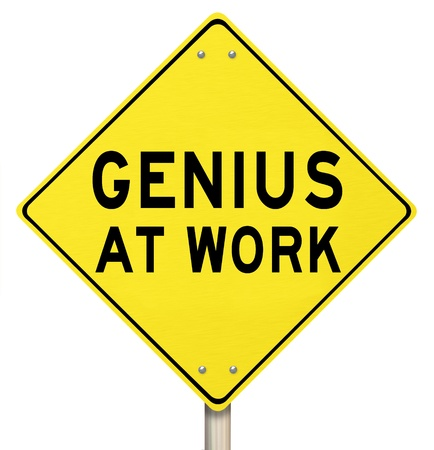 ingenuity: The words Genius at Work on a yellow road sign to give you warning that someone smart, brilliant, intelligent or extremely knowledgable is working on a project or goal