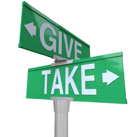 charitable: The words Give and Take on two-way road signs to illustrate the hoice between sharing with others or taking from those in need