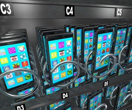 A snack or vending machine full of smart phones or cellphones to illustrate shopping for and buying a new telephone with a contract at a store or market photo