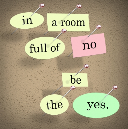 pinned: The words In a Room Full of No Be the Yes saying pinned on a bulletin board