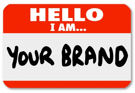 A red nametag sticker with words Hello I Am Your Brand to network yourself and promote your skills and abilities to win new business or land a new job in your career photo