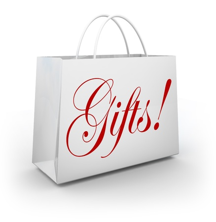 gifting: The word Gifts on a paper shopping bag from an upscale store to illustrate buying merchandise to offer as a present for a birthday, christmas or other special holiday or event