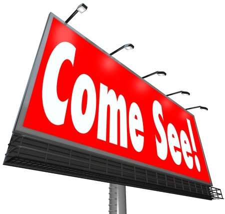 exciting: The words Come See on a large outdoor banner or billboard to adertise a fun and exciting attraction,  special event, store or sale