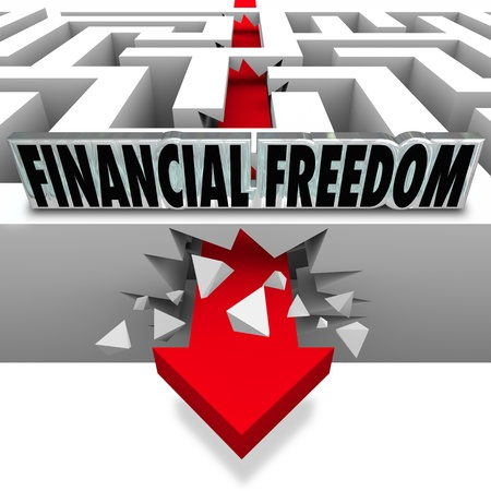 The words Financial Freedom over an arrow breaking through a maze to illustrate solving your money problems such as bills, debt, bankruptcy and insolvency to grow your wealth photo