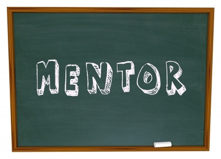 apprentice: The word Mentor on a school chalkboard to illustrate a relationship between a teacher and student, apprentice and mastor, player and coach to learn knowledge and wisdom