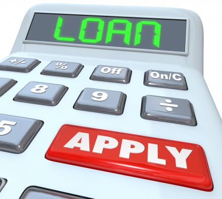 backing: A calculator with the word Loan and a red button with Apply to illustrate submitting an application to borrow money and finance a large purchase Stock Photo