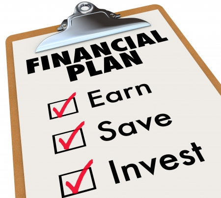 earn more: A clipboard with a financial plan and checkboxes beside the words Earn, Save and Invest to illustrate growing your personal wealth Stock Photo