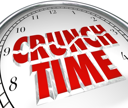 time critical: The words Crunch Time on a clock to illustrate a rush to beat a deadline, or countdown to the final moments of a race or other competition you want to win