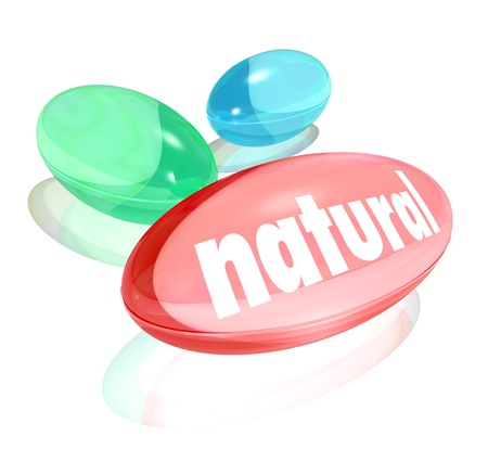 The word Natural on a pill, vitamin or supplement to illustrate the health benefits of an organic or nature based choice for adding healthy qualities into your diet Stock Photo - 20323426