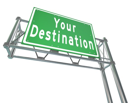 destined: Your Destination words on green freeway road sign directing you to your desired location, attraction or place youve been traveling to
