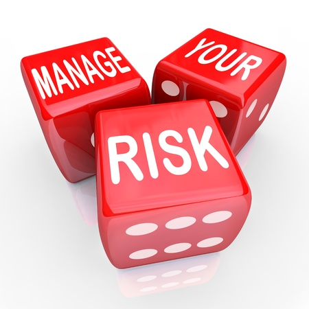 review: Manage Your Risk in a dangerous world, company, workplace or enterprise by reducing costs and liability, illustrated by these words on three red dice Stock Photo