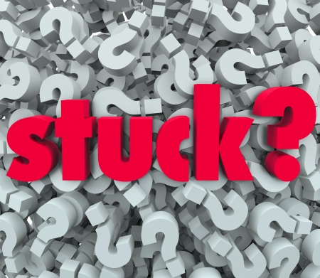 stuck: The word Stuck on a background of question marks to illustrate being caught in a sticky situation, problem, trouble or issue and thinking of a way out or answer