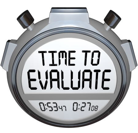 reevaluation: The words TIme to Evaluate on a stopwatch or timer to illustrate assessment, evlauation, grading, reviewing or other form of feedback in work, education or life