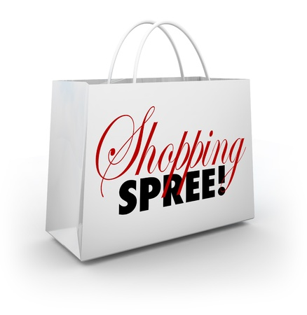 manic: The words Shopping Spree on a white bag for carrying your merchandise at a store or mall as you spend money on goods and products Stock Photo