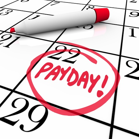 The word Payday circled in red marker on a calendar to remind you of the date you receive your wages, income and earnings so you may budget your finances Фото со стока