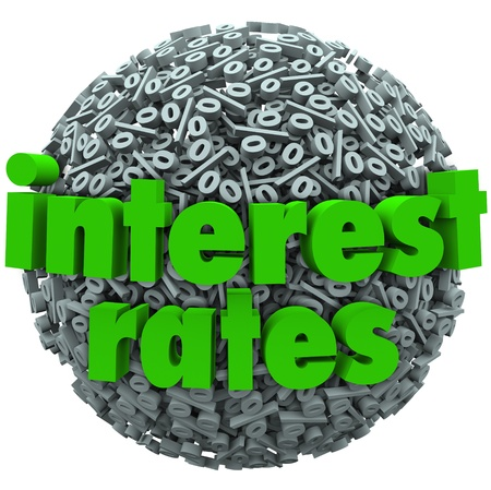 mortgage rates: The words Interest Rates on a sphere of percentage signs to illustrate comparing bank fees and percent rate for loans, mortgage or credit card expenses
