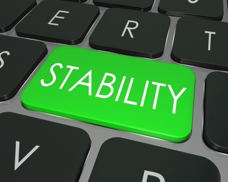 stable: The word Stability on a computer keyboard key to illustrate financial security in investing money for the future, or safe and secure, stable network or architecture for software or programming Stock Photo