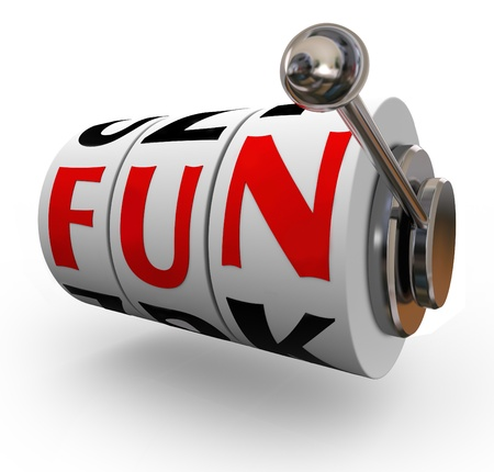 The word Fun on slot machine wheels or dials to illustrate entertainment and enjoyment of having a good time gambling on slots and other games of chance at a casino photo