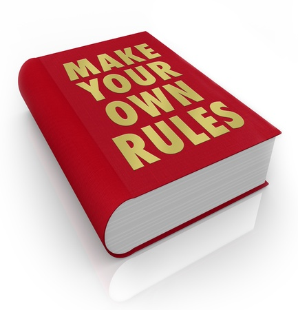 A book with the title Make Your Own Rules to encourage you to take charge and chart your own course to success and happiness Stock Photo - 20622180