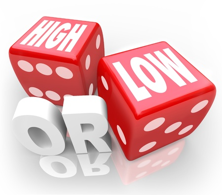 guessing: The words High or Low on two red dice to illustrate a guessing game or gambling to wager on minimum or maximum, more or less