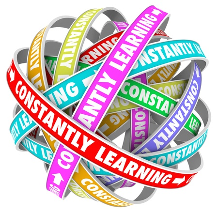 The words Constantly Learning on several colored loops going on for infinity to illustrate continuous growth, education and training to develop skills and improve photo