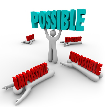 One person lifts the word Possible to illustrate success and winning while others fail and are crushed by Impossible Words 스톡 콘텐츠