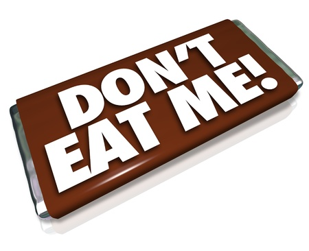 consume: The words Dont Eat Me on a chocolate candy bar wrapper telling you this is unhealthy junk food that you should not consume if you want to lose weight and fat Stock Photo