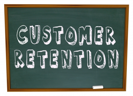 keeping: The words Customer Retention on a chalkboard for a lesson or training in keeping customers for your business Stock Photo