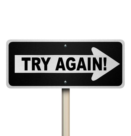 The words Try Again on a one-way road sign to illustrate a second or repeat attempt at a job or task and the determination to complete what you have started Stock Photo - 21130884