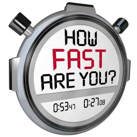The words How Fast Are You? in a question on the display of a stopwatch or timer asking if you are quick enough and have enough speed to get the job done or win a race or competition photo