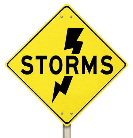 warns: The word Storms on a yellow warning sign and a bolt of lightning icon to  illustrate dangerous thunderstorms Stock Photo