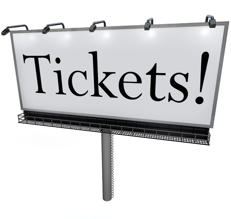 A billboard with the word Tickets to advertise passes or admission is available and to order or buy now to secure your seat or spot on a plan or at a theater, movie, concert or other venue or event Archivio Fotografico