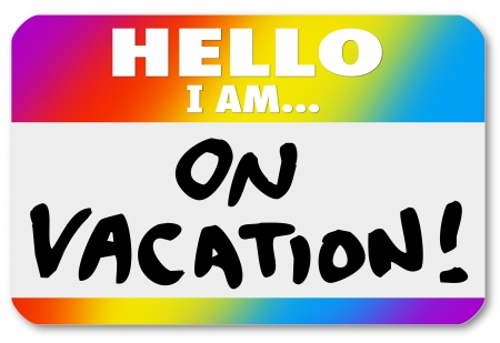 nametag: The words Hello I Am On Vacation on a colorful nametag sticker to illustrate having fun vacationing on holiday, break, recess or sabbatical